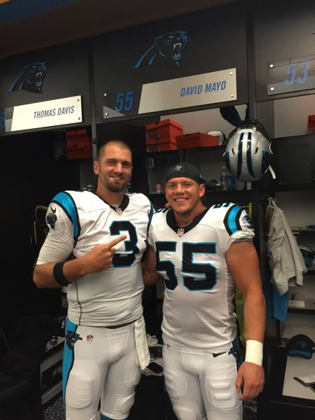 COURTESY: RYAN SVENSON - Derek Anderson and David Mayo pose for a pregame photo in the Carolina Panthers dressing room. Both players hail from Scappoose.
