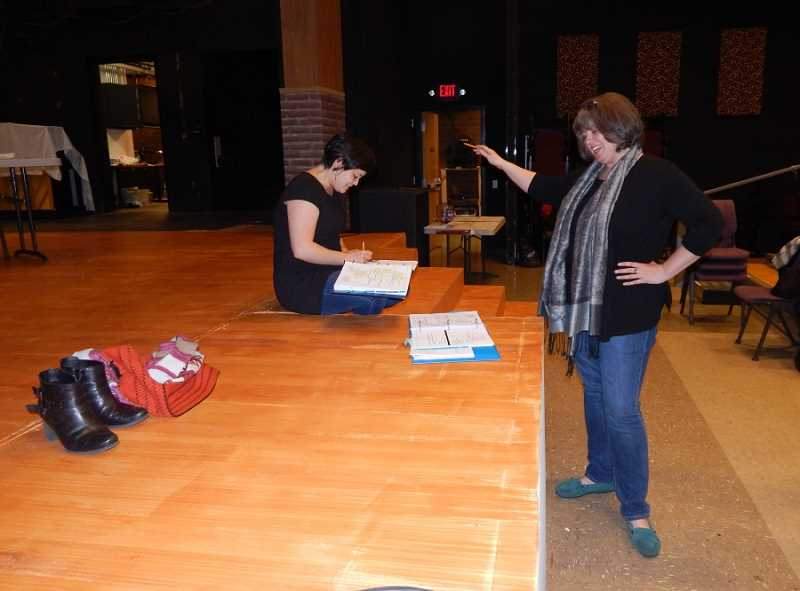 BARBARA SHERMAN - Annie Kaiser (right) works with actress Audrey Voon, who plays one of the kids in the Broadway Rose show, 'The 25th Annual Putnam County Spelling Bee,' during a rehearsal in early January.