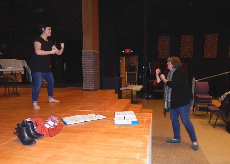 BARBARA SHERMAN - Annie Kaiser (right) shows actress Audrey Voon how she wants her to box in a scene in 'The 25th Annual Putnam County Spelling Bee' that opens Jan. 28.