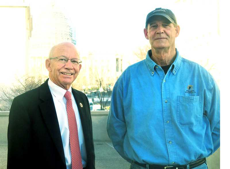SUBMITTED PHOTO - Sending a message - Former Newberg millworker Steve Phillips (right), who was laid off in November, joined Rep. Peter DeFazio at the State of the Union address at the White House last week as an example of the negative impact of 'free trade deals.'