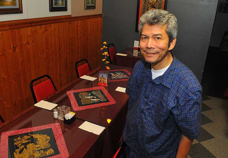 SPOKESMAN PHOTO: VERN UYETAKE - Chai Jivagunchainan put his business background to use when he converted a local teriyaki restaurant into Thai Delight 12 years ago.