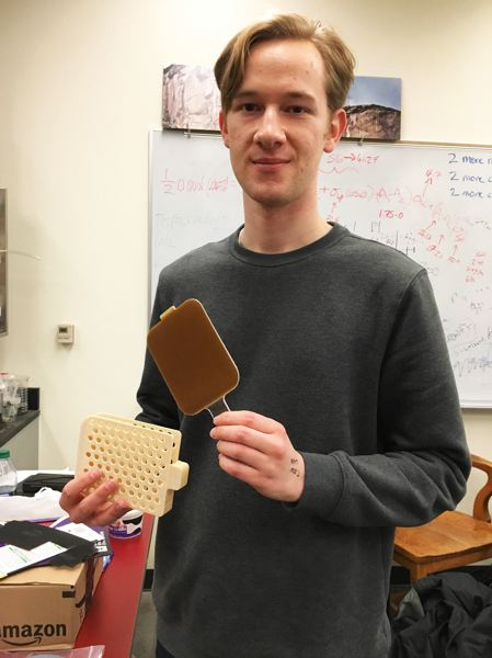 COURTESY: PORTLAND STATE UNIVERSITY - Portland State University mechanical engineering student Karl Cardin with his hydrophobic paddle invention that is now on the International Space Station.