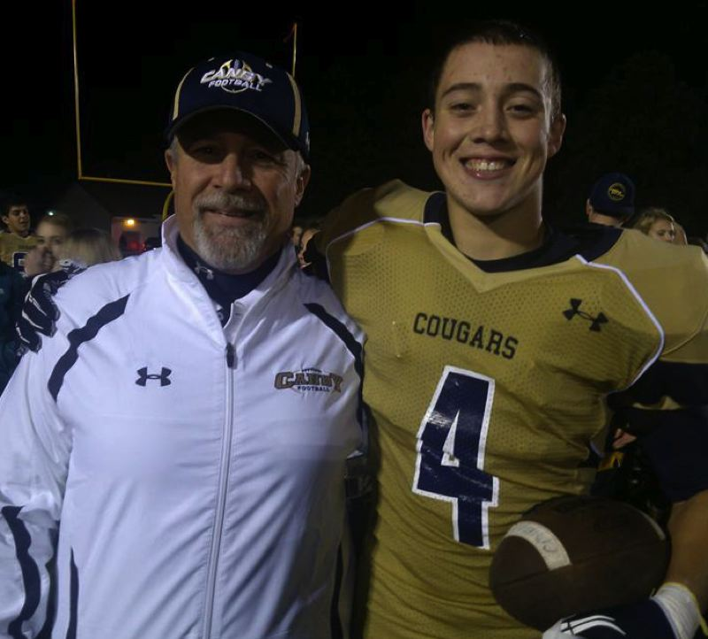 COURTESY: SCHLATTER FAMILY - AJ Schlatter, a star football player for the Canby High Cougars who went on to be a key linebacker for the Portland State Vikings, poses with his dad, Jim, after a prep game.