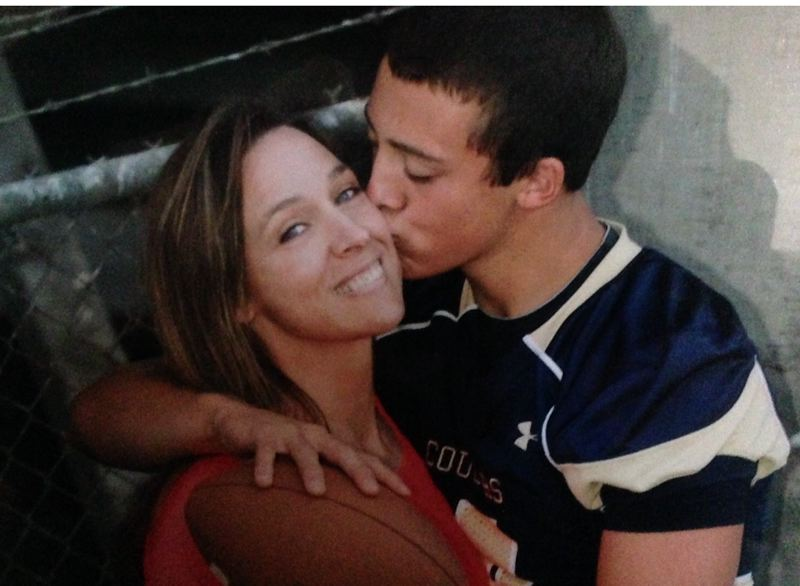 COURTESY: SCHLATTER FAMILY - AJ Schlatter plants a kiss on the cheek of his mother, Terry Jo.