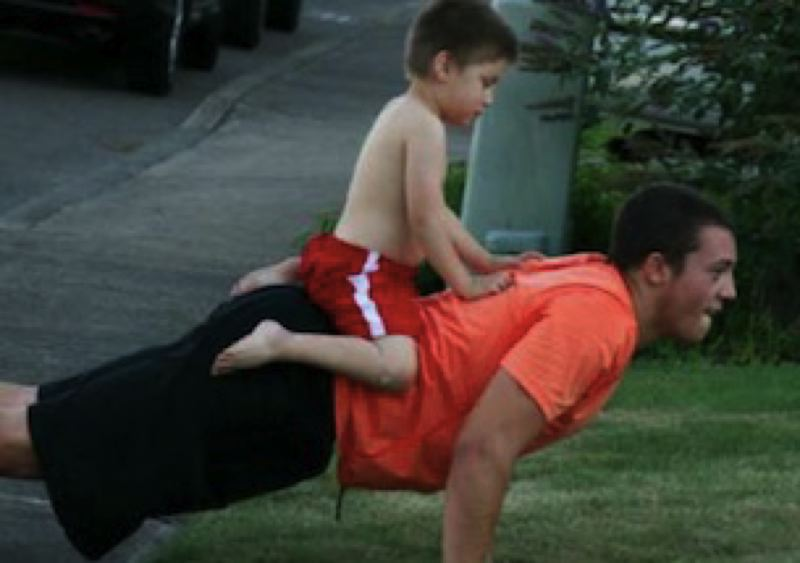 COURTESY: SCHLATTER FAMILY - A cousin gets a ride during push-ups by AJ Schlatter.