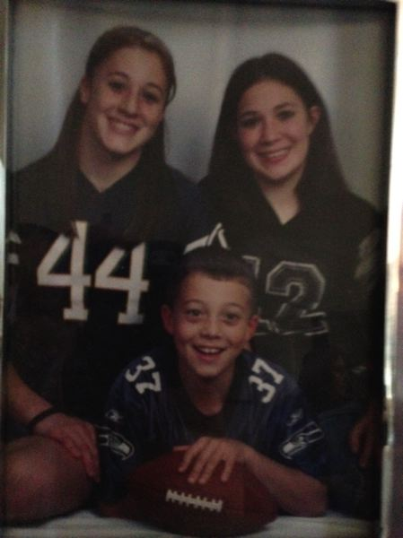 COURTESY: SCHLATTER FAMILY - Young AJ Schlatter, with sisters Garyn (left) and Kasey, liked to play imaginary football games by himself in the backyard.