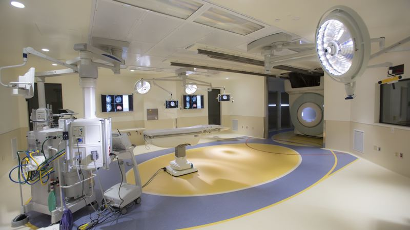 COURTESY PHOTO: OHSU - The new $19 million surgery suite at OHSU's Doernbecher Children's Hospital includes an interoperative MRI machine that staff can move into position around the patient using an overhead track.