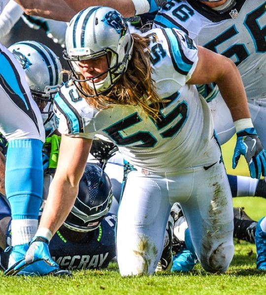 PAMPLIN MEDIA GROUP PHOTO - David Mayo completes a play during a Carolina Panthers game against the Seattle Seahawks in January. Mayo, who played high school football in St. Helens and Scappoose, will compete with his team in Super Bowl 50 on Feb. 7.