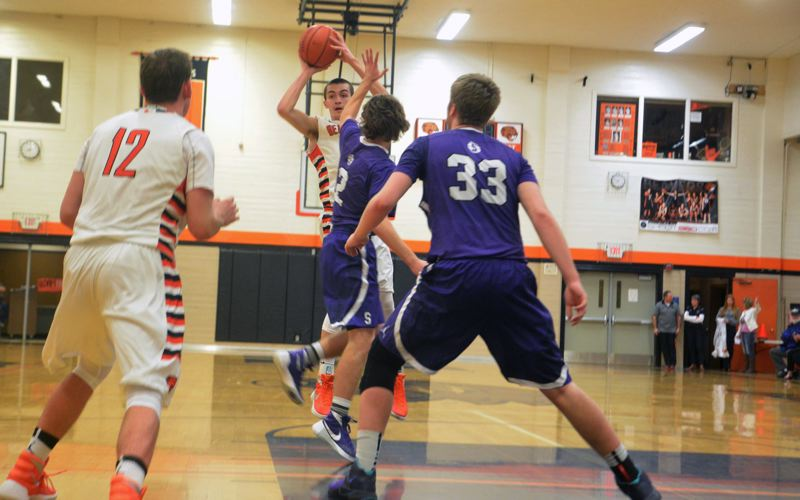 TIMES PHOTO: MATT SINGLEDECKER - Beaverton junior Nolan Bertain looks for an open teammate in the third quarter against Sunset