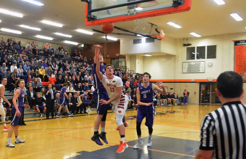 TIMES PHOTO: MATT SINGLEDECKER - Beaverton junior forward Hunter Sweet ducks under a Sunset double team for two against the Apollos on Friday night.
