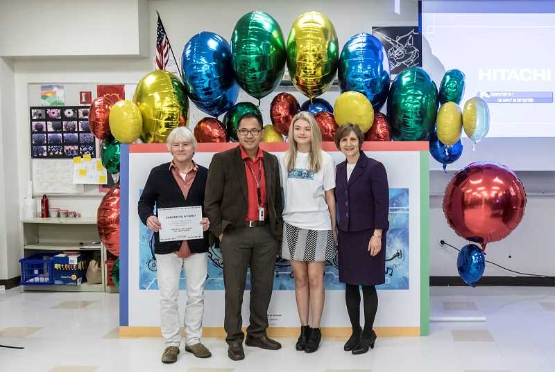 TIMES PHOTO: JONATHAN HOUSE - Westview High School art teacher Kim Short (from left), principal Jon Franco, senior Bailey Volchok and Congresswoman Suzanne Bonamici pose for photographs during a celebration of Volchok's prize-winning Google doodle.