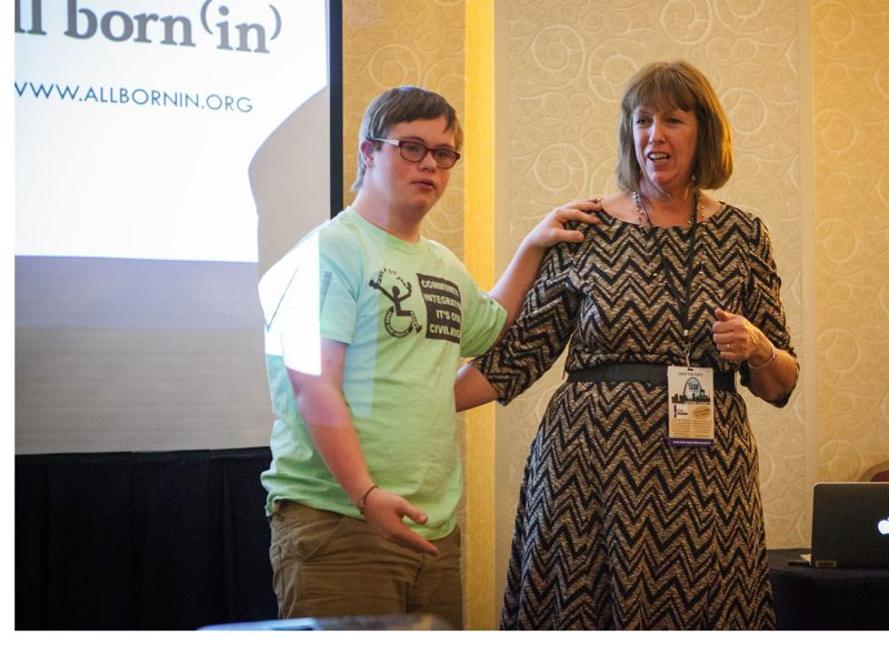 TRIBUNE FILE PHOTO - Angela Jarvis-Holland, executive director of All Born (In), makes a presentation in December with her son Daniel on the need for integration of students with disabilities in mainstream education.