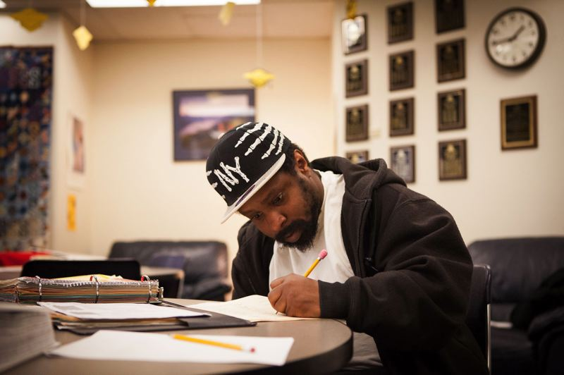 TRIBUNE FILE PHOTO  - GED student Marquez Goldsby works in the lobby of Londer Learning Center last April.