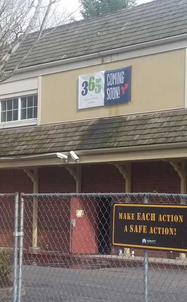 REVIEW PHOTO: GARY M. STEIN - Construction fencing surrounds the former home of Albertsons on State Street in downtown Lake Oswego, where a 365 by Whole Foods Market is tentatively scheduled to open in July.
