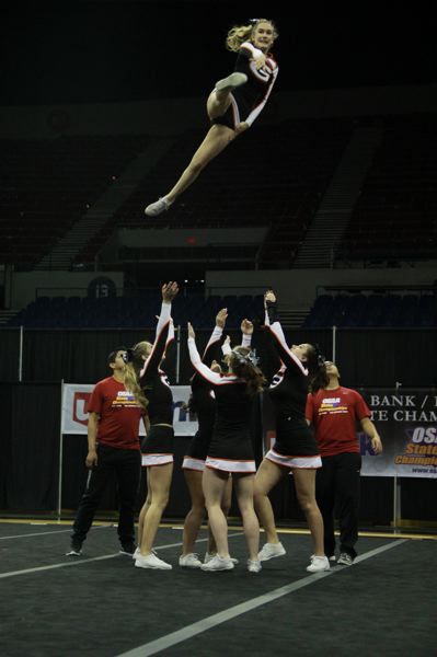PHOTO BY JONATHAN SANCHEZ - Gladstone High School cheerleaders are especially good at tumbling and jumping, as judges for the championships rating these skills highest among any large team from a 4A school in the state.