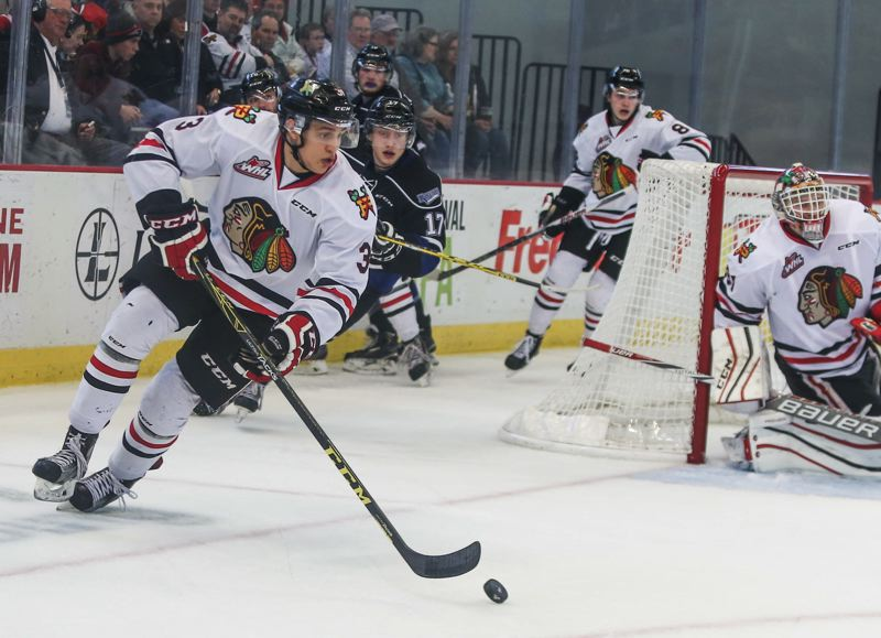 COURTESY: DAYNA FJORD/PORTLAND WINTERHAWKS - Caleb Jones, Portland Winterhawks defenseman, circles the net with the puck during Monday's daylight game at Memorial Coliseum. Jones scored in overtime to beat the Victoria Royals 2-1.