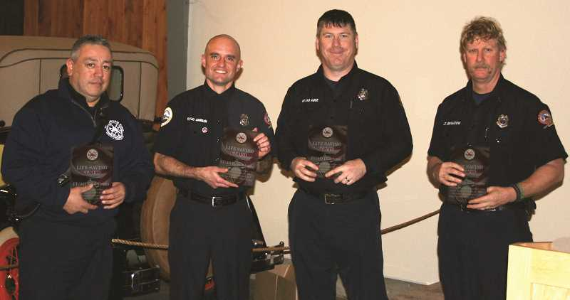 COURTESY PHOTO: WFD - 2016 Lifesaving Award winners (pictured from left): FF/AO Raul Garza, FF/AO Ryan Johnson, FF/AO Dan Agee and Lt. Robb Gramzow for their code save on Oct. 26, 2015.