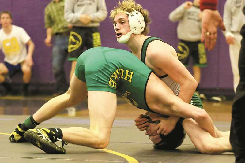 JO WHEAT - North Marion senior Casey Roberts was one of seven Huskies who advanced to the bracket championship of the 4A Special District 2 regional tournament on Saturday. Roberts went on to win the 132-pound final, joining junior teammate Lane Stigall as regional champions.