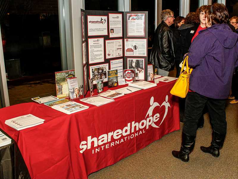 NEWS-TIMES PHOTO: TRAVIS LOOSE - In the hall outside Taylor-Meade auditorium, Shared Hope and other organizations held a How Can I Help Fair, where attendees had the opportunity to connect with groups and get involved.