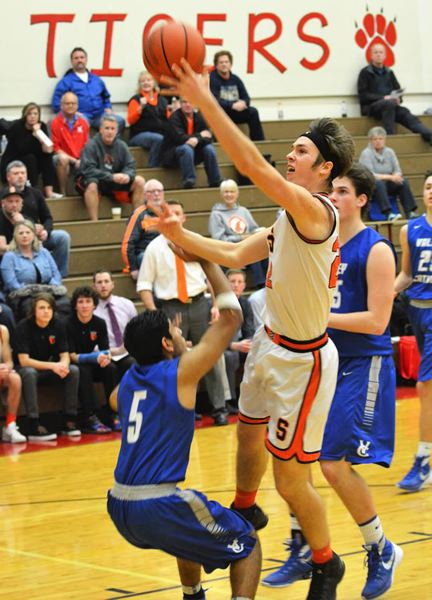 SPOTLIGHT PHOTO: JAKE MCNEAL - Indians senior Ian Donaldson's up-and-under with 6.3 seconds left in overtime helped No. 6 Scappoose beat No. 8 Valley Catholic 58-54 for the third Cowapa League seed on Tuesday at Clatskanie Middle/High School.