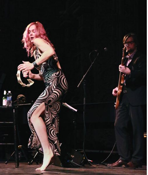 COURTESY PHOTO: JANICE PIERCE - Barefoot and banging a tambourine,  Large performs with bandmate and bass player Matt Brown.