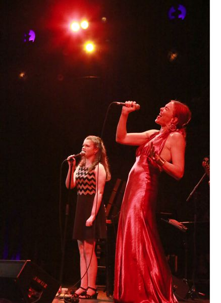 TRIBUNE PHOTO: JANICE PIERCE - Large invited young talent Sarah Hardwig onstage. Hardwig did not disappoint as she and Large sang a duet on 'Somebody to Love.'