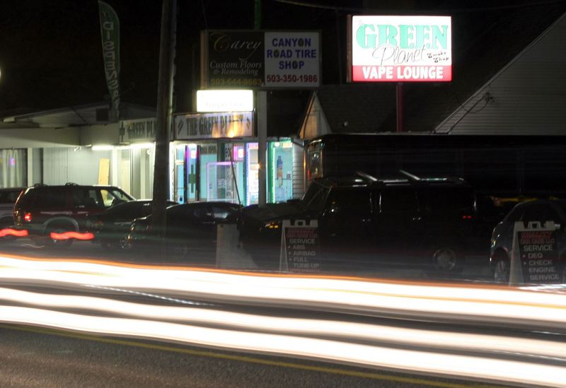 TIMES FILE PHOTO - The Green Planet Smoke Shop' which added medical marijuana to its Southwest Canyon Road businesslast spring, and other Oregon marijuana sellers are paying taxes now, but schools won't see their shareof that cash until the summer of 2017 at the earliest.