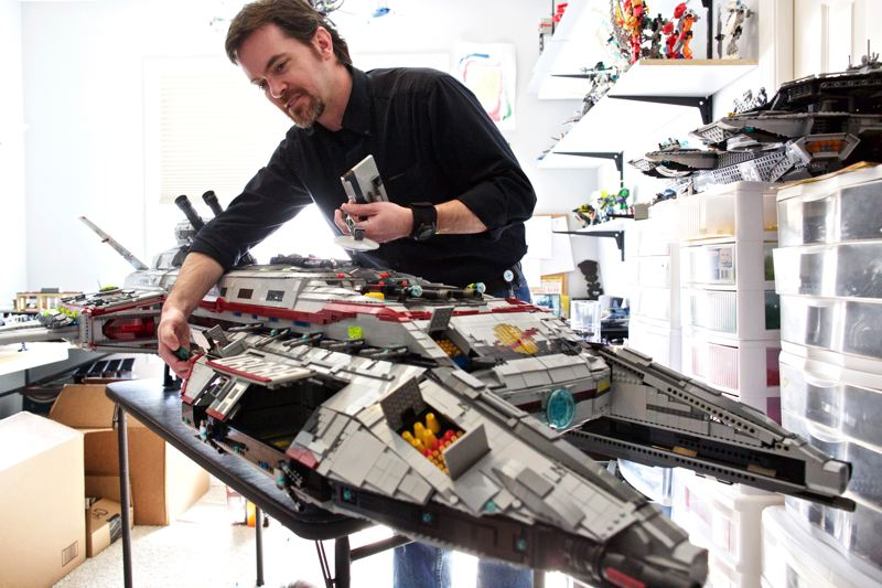 TIMES PHOTO: JAIME VALDEZ - Jeff Bergquist of Bethany shows the compartments of a space ship that he made from LEGOs. Bergquist is one of the organizers of Bricks