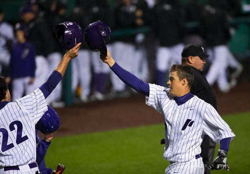 COURTESY: UNIVERSITY OF PORTLAND - Freshman Cody Hawken (right) is greeted at home plate after one of his two home runs Friday night under the lights and in the rain at Joe Etzel Field.