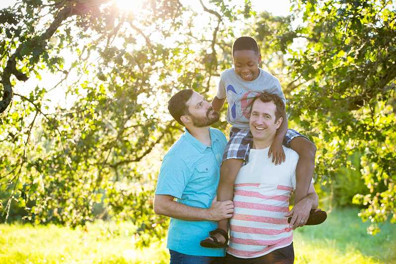 SUBMITTED PHOTO - From left: Ben West with his son Jay Rummellwest, 10, and husband Paul Rummell.
