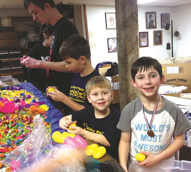 SUSAN WILLIAMS - Molalla High School and Country Christian School Key Clubs have been busy stuffing eggs along with Molalla Cub Scouts from Pack 257 for the Annual Kiwanis Community Easter Egg Hunt.