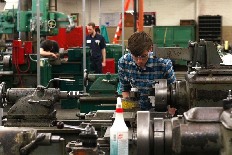 TRIBUNE PHOTO: JONATHAN HOUSE - A Benson Polytechnic High School student works in a shop class. Career-technical education is widely seen to be Benson Techs major advantage in graduating a wide demographic of students at similar rates.