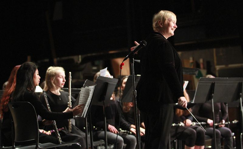 TIMES PHOTO: MILES VANCE - Kathy Brown, a student teacher assisting the band program at Beaverton High School, got a chance to direct one of the pieces during the Beaverton High School Bands & Ensemble WInter Concert.