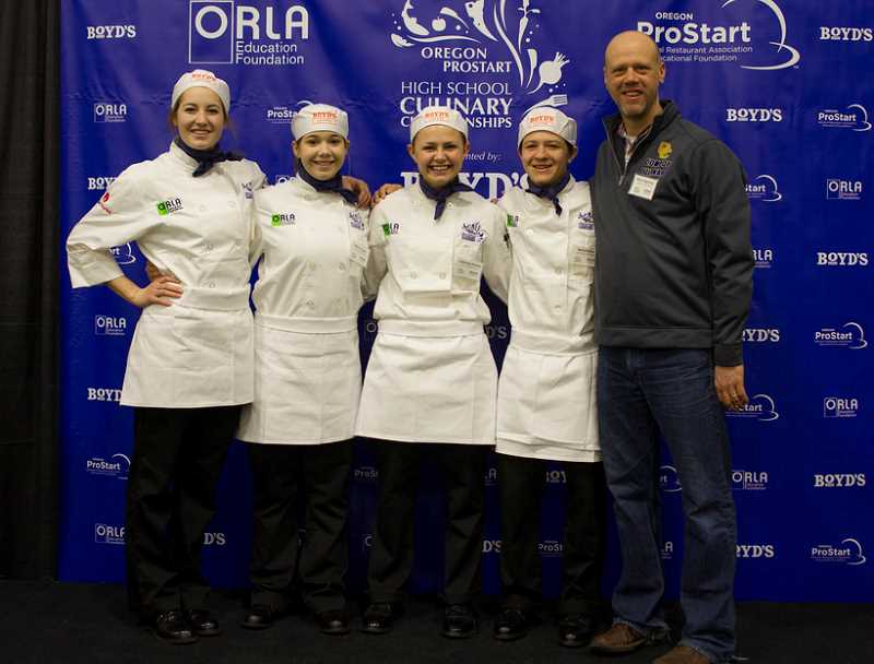 CONTRIBUTED PHOTO - The Crook County High School Culinary Arts students pose for a photo in their chef's jackets during the Oregon ProStart High School Culinary Championships. Pictured left to right are Laura Fraser, Monica Lopez, Courtney Austin, Neil Chaney and instructor Macy Hagensee.
