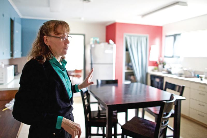 PORTLAND TRIBUNE: JAIME VALDEZ - Community of Hope program director Linda Jo Devlaeminck stands in the shelter's kitchen. The planned expansion would add showers and more food storage, among other things.