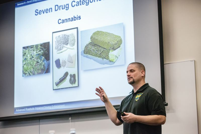 PORTLAND TRIBUNE: JONATHAN HOUSE - Portland Police officer Nathan Scott leads a class on how to spot marijuana and other drug use by drivers during traffic stops. Police statewide have been ramping up the training since marijuana legalization last October.