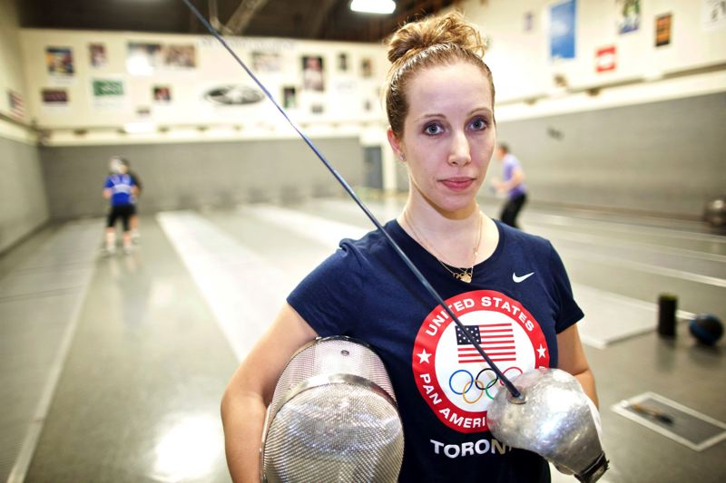 TRIBUNE PHOTOS: JAIME VALDEZ - Mariel Zagunis is a two-time Olympic gold medalist and world fencing champion. She trains at the Oregon Fencing Alliance with her longtime coach, Ed Korfanty, and will compete in the 2016 Games at Rio de Janeiro.