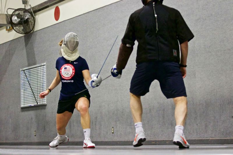 TRIBUNE PHOTO: JAIME VALDEZ - Fencing star Mariel Zagunis (left) of Beaverton has worked on all aspects of her sport, including new strategies, in order to keep competitive at the world level.