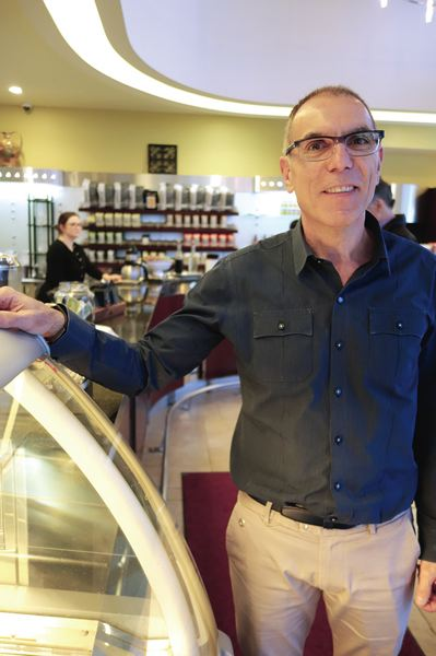 TRIBUNE PHOTO JOSEPH GALLIVAN  - Caffe Umbria co-owner Pasquale Mededdu will put his prices up to pay for his staff's leap from $11 an hour (plus tips) to $14.75 by 2022.