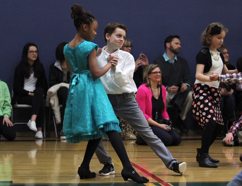 TIMES PHOTO: MILES VANCE - Princess Frazier and George Henson, both fourth-graders at Mary Woodward Elementary School in Tigard, strike a pose during the ballroom dancing showcase and friendly competition at Twality Middle School on Monday night.