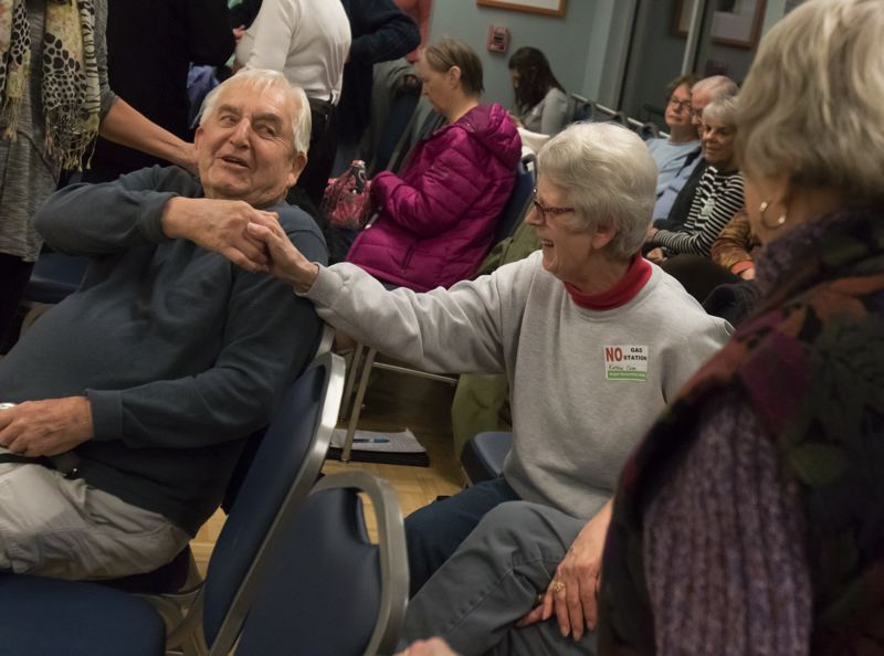 TIMES PHOTO: JONATHAN HOUSE - Kathie Cole, center, shakes hands with land owner Bob Stein after he told the Tualatin City Council that he will not seek to build a gas station on his property after all, due to neighbors' concerns.