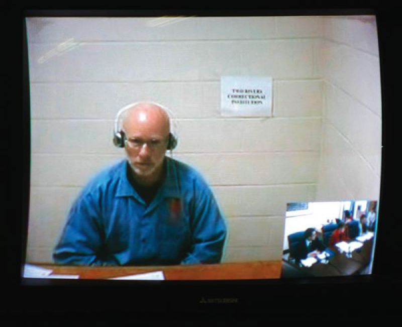 TRIBUNE FILE PHOTO  - Serial rapist Richard Troy Gillmore appeared via satellite for his 2012 parole hearing.