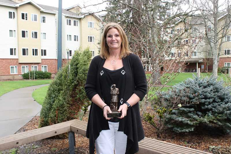 SUBMITTED - Deborah Cochell was recently honored with the Veterinary Service Award by the Oregon Veterinary Medical Association.