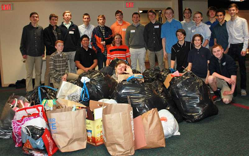 SUBMITTED PHOTO: DIANE GEROT - At their first official meeting in February, members of the Lake Oswego chapter of the National League of Young Men collected 30 bags of clothing for Northwest Children's Outreach.