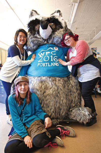 TRIBUNE PHOTO: JAIME VALDEZ - Franklin High School Cosplay Club members Annie Bui, sophomore, top left, Cayla Curry, sophomore, and Audrey Finley, freshman, helped art teacher Carrie Berning build Parky the Raccoon, who is the mascot for the 4th World Parkinson Congress in Portland.