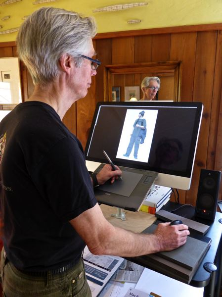 SUBMITTED PHOTO - Oak Grove resident  Michael Hoeye works at his computer, refining an image from 'Angels Passing,' his current exhibit at the Portland International Airport.