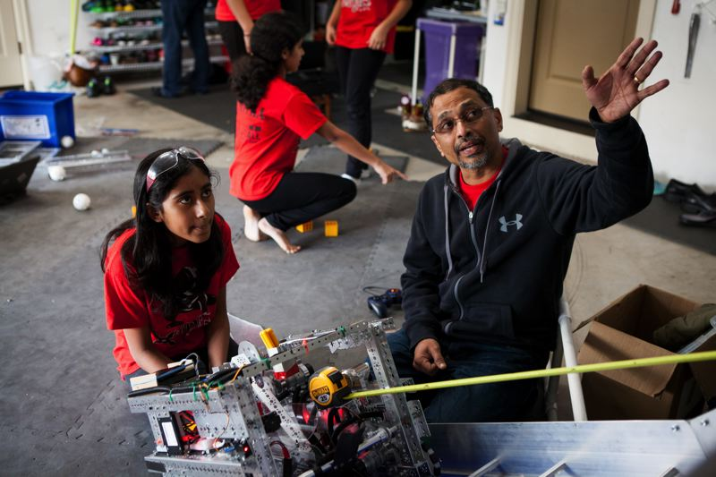 TIMES PHOTO: ADAM WICKHAM - Coach Xavier Nixon helps Nano Ninjas member Ramya Reddy prepare Chanel the robot for this week's super-regional competition.