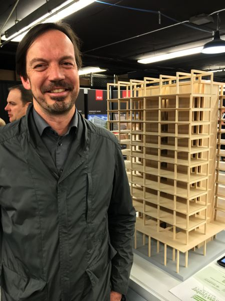 BUSINESS TRIBUNE: DEAN BAKER - Portland Architect Thomas Robinson stands by a model of Framework, the wooden building his company is going to build at 430 N.W. 10th Ave.