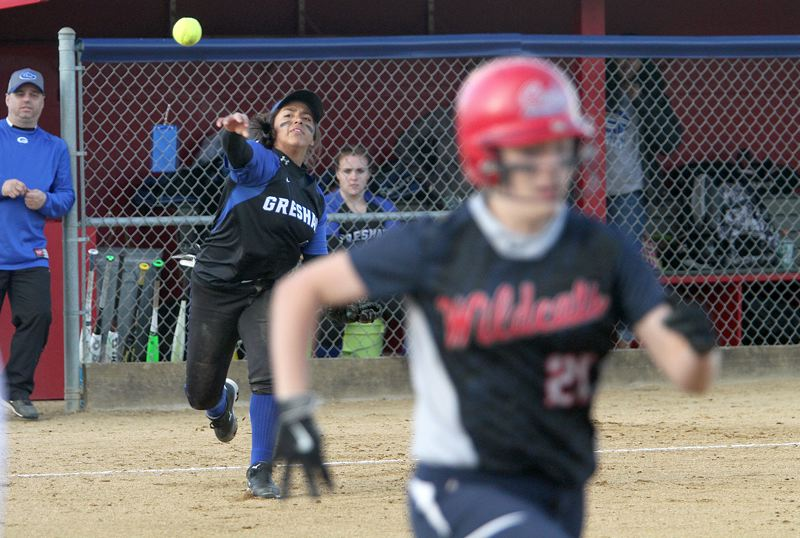 TIMES PHOTO: MILES VANCE - Gresham third baseman Bella Serrano throws to first base during her team's 12-4 non-league loss at Westview on Monday.