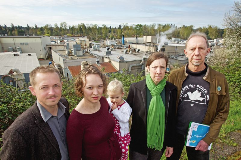 PORTLAND TRIBUNE: JAIME VALDEZ - Jacob Sherman along with his wife, Martha, and daughter, Caroline, stand with neighbors Meg Van Buren and her husband Albert Zayha, above Precision Castparts plants in Southeast Portland and Milwaukie. They live near the plants and are concerned by the metals company's air emissions and possible other discharges into Johnson Creek.